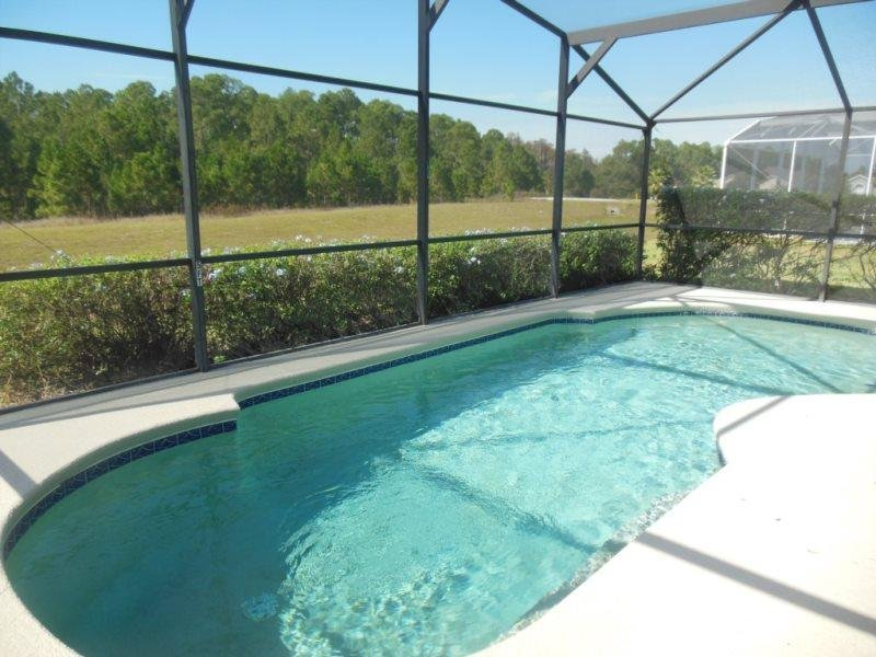 Stunning 3 Bed 2 Bath Pool Home with Jacuzzi Only 9 miles from Disney. 335BD - Image 1 - ChampionsGate - rentals