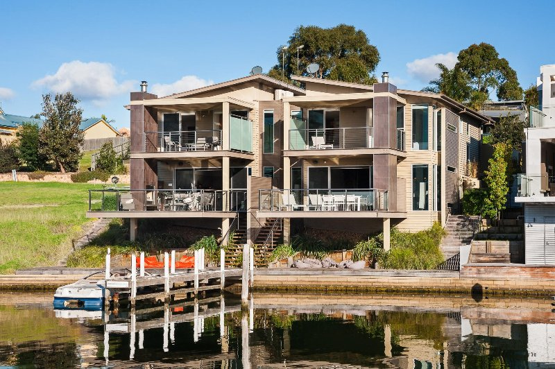Exterior of house from across the canal - Luxury Waterfront Accommodation with Private Jetty - Paynesville - rentals
