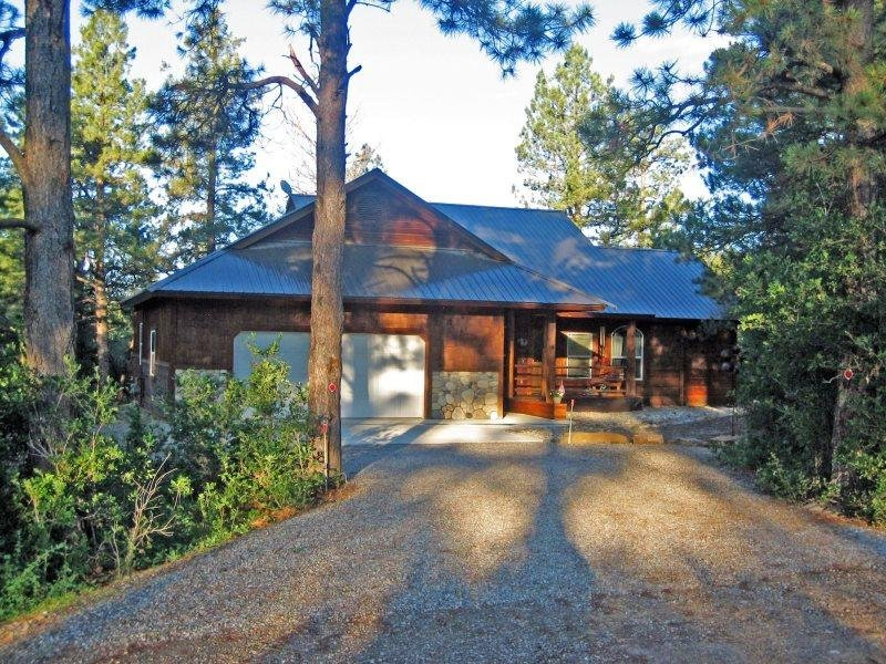 Capitan is a beautiful vacation home in Pagosa Springs backing up to the - Image 1 - Pagosa Springs - rentals