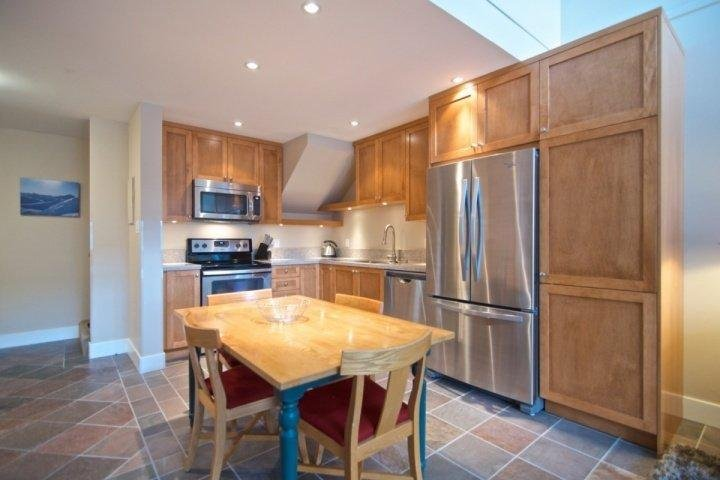 New open kitchen, stainless steel appliances, oak cabinets and granite counters - Glacier Lodge Unit 339 - Whistler - rentals