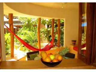 Patio from kitchen - Luxurious Poolside 1BR Condo near beach & markets. - Zihuatanejo - rentals