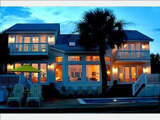 A night view of house from garden with evening lights on - Hilton Head 6Bd6Ba Direct Oceanfront Vacation Home - Hilton Head - rentals