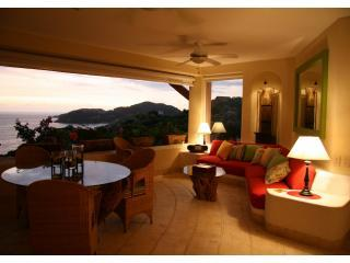 Living Room, Dinning Room at dusk_resize.JPG - Marlin House  Overlooking  La Ropa Beach - Zihuatanejo - rentals