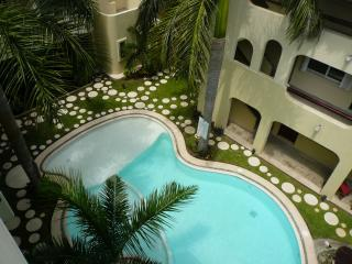 Courtyard and Pool View from Living Room Balcony - Lovely Penthouse Condo, Close to 5th Av and Beach - Playa del Carmen - rentals