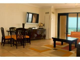 Living/dinning area with plasma screen TV - Beachfront Villa at Wyndham Rio Mar Beach Resort - Rio Grande - rentals