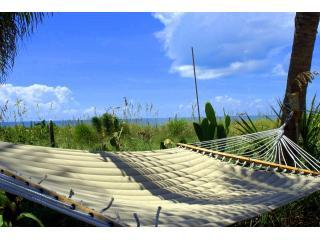 """Relax in luxury on Captiva's most charming beach location - Charming Gulffront """"on the beach"""" Coquina Cottage and amazing tropical beach gardens. - Captiva Island - rentals"""