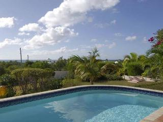 Enjoy an easy walk to spectacular Meads Bay Beach from this relaxing villa. IDP JAS - West End Bay vacation rentals