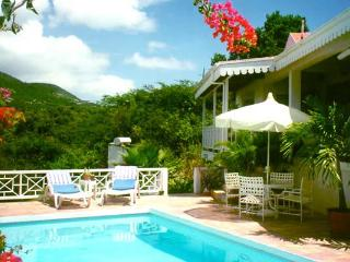 Gingerbread cottage with sunset ocean views and Mt. Nevis with guest cottage. KL FAR - Nevis vacation rentals