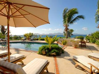 Overlooking the mountains of St. Martin, this secluded cove villa is perfect for sunning or swimming. RIC COY - Anguilla vacation rentals