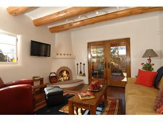 Enjoy the comfy living room seating and open the doors to the garden for a breath of fresh air. - Live In The Wraps of Luxury….wine,dine,shop 2blks. - Santa Fe - rentals