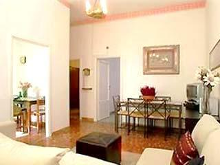 Tastefully furnished large living/dining room w/ sofabed for 2.  TV with satellite Sky channels - 2 Bedrooms/ 2 Baths LOVELY HOME By The Colosseum - Rome - rentals