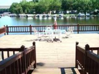 Access to large deck over water for our condo guests located just across the drive a few steps away. - 2 Level Condo w/ Access to Water, Deck, BoatLift - Monticello - rentals