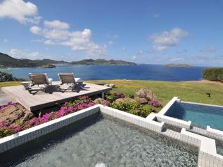 Contemporary villa with stunning views and the sunrise from the east WV SEA - Pointe Milou vacation rentals