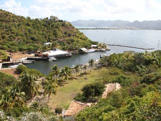 ALIZES... large lagoon waterfront villa with boat dock & tennis court! - Terres Basses vacation rentals