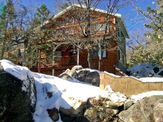 A two-story Big Bear cabin rental that is perched on a hillside just above Bear Mountain Ski and Golf Resort. - Big Bear Lake vacation rentals