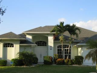 Adagio Villa - dual-heated pool, huge lanai, on a gulf access canal - Cape Coral vacation rentals