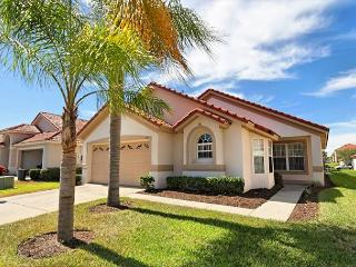 GLINTON: 4 Bedroom Pool and Spa Home in Gated Resort Community with Game Room - Disney vacation rentals