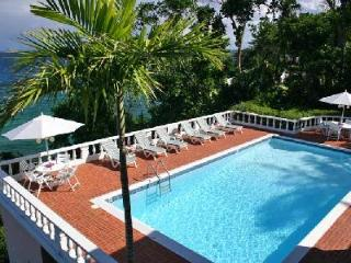 Waterfront Emerald Seas - with lush grounds, pool, tennis & full staff - Ocho Rios vacation rentals