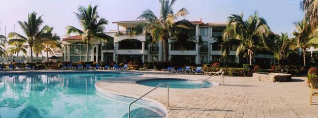 Broad view of one side of villas., includes kid's pool, main pool and hot tub - Deluxe 5 Star 1 bdrm Villa at Grand Marina Villas - Nuevo Vallarta - rentals