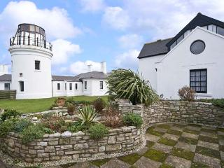 OLD HIGHER LIGHTHOUSE BRANSCOMBE LODGE, family friendly, character holiday cottage, with pool in Portland Bill, Ref 12497 - Dorset vacation rentals
