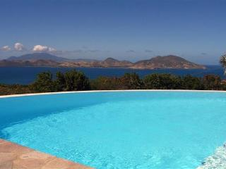 Ocean views towards St. Kitts, this villa blends Mediterranean and French Antillean architecture. WA CAS - Saint Kitts and Nevis vacation rentals
