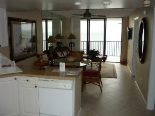 Kitchen & Living view - Trendy Tommy Bahama Theme Beachfront Condo - Marco Island - rentals
