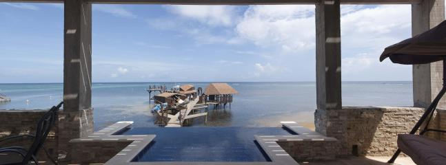 BEACHFRONT HOME IN SANDY BAY 5 BEDROOM 5 BATH