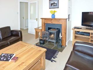 TAIGH AN TOBAIR (HOUSE BY THE WELL), detached cottage, with stunning views, woodburning stove, and garden, in Colbost, Ref 14611 - Dunvegan vacation rentals