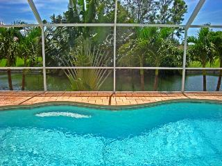 Vacation home by the water with Tiki Bar in Cape C - Cape Coral vacation rentals