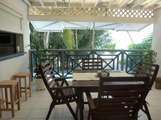 Emerald -  apartment on the beach + pool access - Baie Nettle vacation rentals