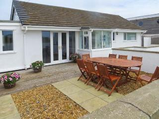 ST WINIFREDS, detached coastal single-storey cottage, pet-friendly, external garden room, parking, enclosed patio, in Rhosneigr  - Rhosneigr vacation rentals