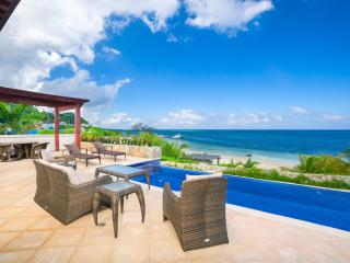 Escape Into Beachfront Luxury at Pristine Bay - Sandy Bay vacation rentals