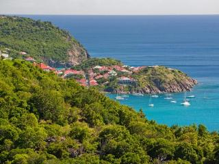 All about the view - built against green cliffs on the south side of Colombier. WV VAN - Colombier vacation rentals