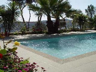 Ocean and pool views from this modern Italian villa. AZR 257 - Théoule sur Mer vacation rentals