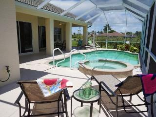 Tropical Haven - Cape Coral 4 b/2.5 ba deluxe home w/electric heated pool/spa, gulf access canal, HSW Internet, Boat Dock - Cape Coral vacation rentals