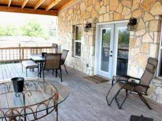 Watch the sunset off the covered porch overlooking the 40 acre pecan orchard - Hill Country Hideaway (The Rock House) - Bandera - rentals
