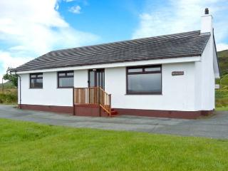 DEO-NA-MARA, single-storey cottage, spacious accommodation, enclosed gardens, sea and mountain views, in Borreraig, near Dunvega - North Uist vacation rentals