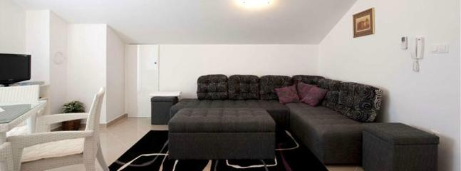 01_Sofa in living room - Charming apartment  Bety 10 for 3 pax with sea view in Novaljav - Novalja - rentals