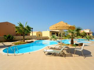 Luxury apartment by the sea with  pool and supreb sunsets - Roustika vacation rentals