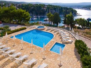 Exclusive beach apartment with swimming pool, Cro - Cove Makarac (Milna) vacation rentals