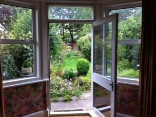 French doors from living room to garden all on one level - Smuggler's Cottage garden, parking and fast WIFI - Red Cloud - rentals