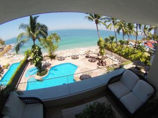 Beach front condo with private beach and 2 pools. - Puerto Vallarta vacation rentals