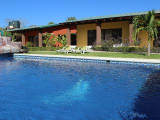 Colorful gardens, pool, hammocks and bbq! 6 Person - Playa Flamingo vacation rentals