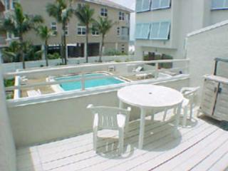Porch with view of pool area - Coquina Beach Club - Bradenton Beach - rentals