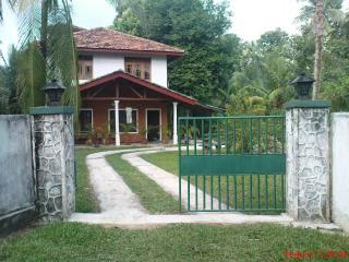 Holiday cottage bordering river with birds & trees - Rekawa vacation rentals
