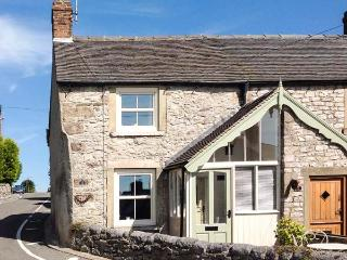 12 THE GREEN, romantic cottage, woodburning stove, patio with village views, en-suite, in Middleton Ref 16437 - Wirksworth vacation rentals