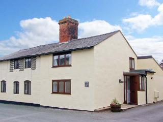 PEAR TREE COTTAGE, 19th century cottage, enclosed patio, ideal for a family or couple, two mins walk from a castle, in Whittington, Ref 23102 - Oswestry vacation rentals