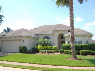 """ALL SUITE MANOR: 5 Bedroom Pool and Spa Home with 80"""" TV and 5 Suites! - Davenport vacation rentals"""