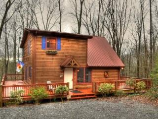 Enjoy the large and spacious deck on this vacation cabin for relaxation and entertaining, and the scenic views of the forest. Tu - Blue Ridge vacation rentals