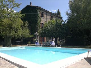 5 bedroom, 3 storey villa in Tuscan village features private pool, veranda and garden - Castelnuovo di Garfagnana vacation rentals